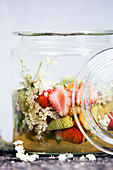 Preserved red and green strawberries with elderflower syrup