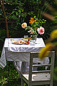 Table in the garden with flowers