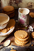 Homemade malted milk biscuits alongside a cup of tea and a jug of milk