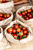 Cherry tomatoes in paper bags