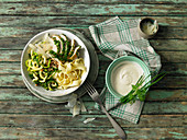 A courgette pasta bowl with wild garlic and herb chicken breast