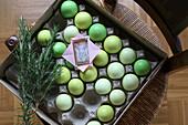Small Easter gift on green Easter eggs in egg carton