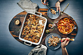 Pasta bake with caramelised onions, and rigatoni with pumpkin bolognese