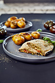 Vegan aubergine cordon bleu with pesto potatoes