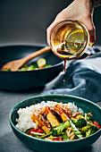 Vegan teriyaki tofu with fried vegetables and basmati rice