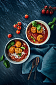 Vegan tomato soup with rice, soya 'meatballs' and cashew nut cream