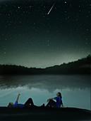 Couple watching shooting star, illustration