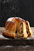 Kärntner Reindling (rolled yeast dough cake filled with suagr, cinnamon, raisins and butter)