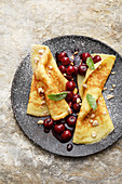 Pancakes with sour cherries and caramelised almonds