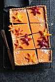 Coconut and orange tart, sliced