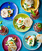 Arepas with fried eggs, prawns and avocado