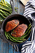 Roast duck breast with green asparagus