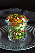 Arugula salad with tomatoes, egg, red salmon caviar, parmesan cheese, green onion and garlic croutons