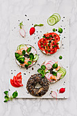 Breakfast bagels with cucumber, chorizo, salmon and radish