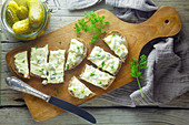 Bread with egg salad and gherkins