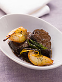 Braised shoulder of venison with caramelised pears