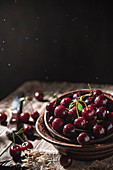 Wet cherries in a clay bowl