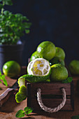 Fresh wet limes in a wooden box