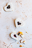 Heart shaped cookies with raspberry jam (and a broken heart)
