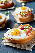 Crostini with bacon, spring onions and quail's eggs