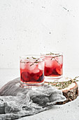 Plum lemonade with ice and thyme