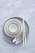 Soup bowl, cereal bowls, plates, chopsticks and soup spoons
