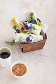 Summer rolls filled with kelp noodles and edible flowers