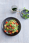 Green chlorella tagliatelle with tomato sauce