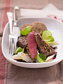Saddle of venison with Brussels sprouts leaves