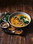 Spice-roasted pumpkin soup with macadamia dukkah