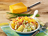 English potato salad with sour cream, bacon bits and Cheddar cheese