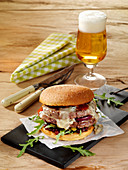 A beef burger with bourbon onions and Gorgonzola