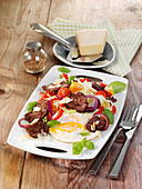 Farmhouse-style steak salad with a fried egg