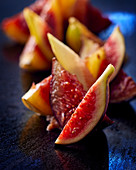 Fig wedges on a black surface