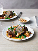 Beef roulade with a tofu and vegetable medley