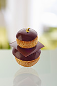 A chocolate religieuse with gold leaf
