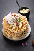 Waffles with vanilla and pecan nut ice cream, apple sauce and apple compote