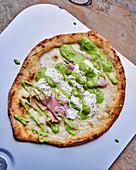 Pizza with mortadella and pistachio cream