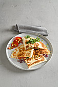 Stuffed quesadilla sandwiches with pepper, bacon and sour cream