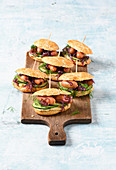 Sausage burgers with cucumber, red onions and mustard