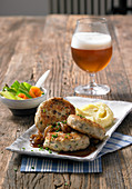 Cod cakes with an onion and beer sauce and mashed potatoes