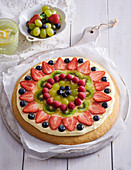 Sweet pizza with kiwi and berries