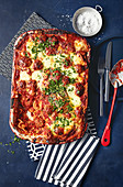 Calabrian lasagne with boiled eggs, mortadella, prosciutto and mozzarella