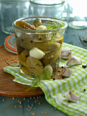 Gherkins and garlic in a preserving jar