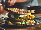 A toasted avocado sandwich with mango chutney