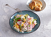 Egg salad with radish and red onions