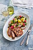 Steak with potato and radish salad