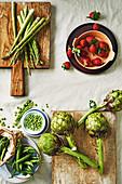 Green asparagus, artichokes, peas and strawberries