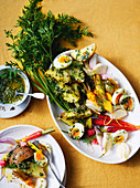 Vegetable and egg platter with herb sauce