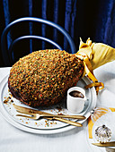 Glazed roast ham with a crust of parsley crumbs for Christmas